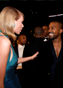 Taylor Swift and Kanye West talking to each other at the Grammy Awards 2015